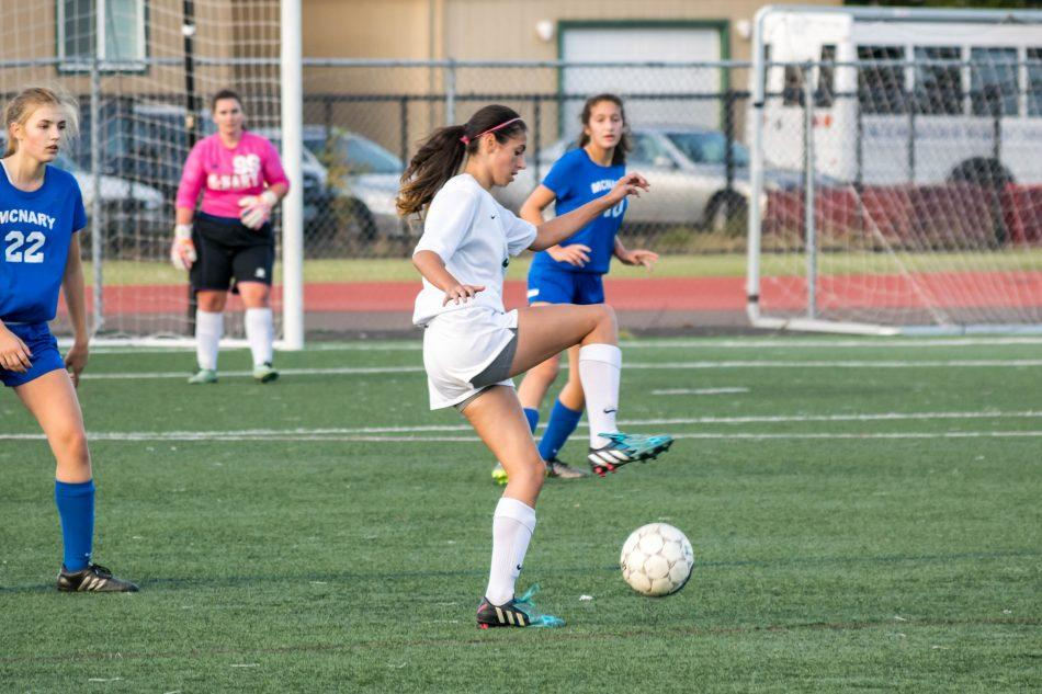 Junior Cora Rainwater takes control of the ball in a junior varsity girl