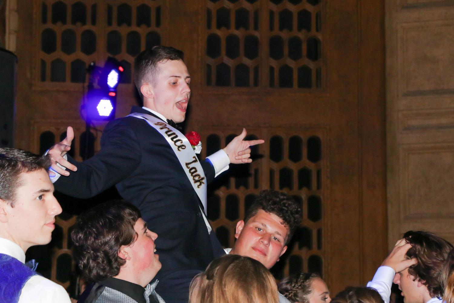 Last+years+prom+king%2C+Zack+Dean%2C+being+lifted+by+the+crowd+at+prom.