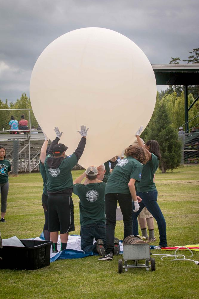 The tech team practices for the Aug. 21 balloon launch at THS on Saturday, May 20.
