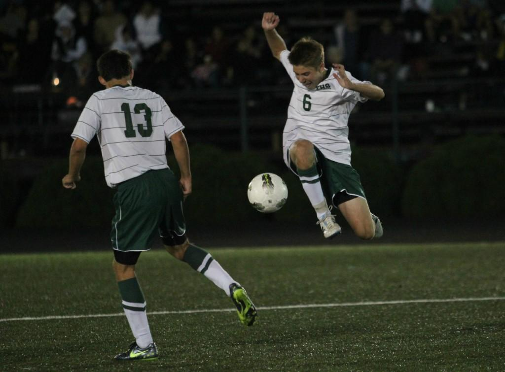 Sophomore Ben White kicks the ball at the last second of the game against Newberg.