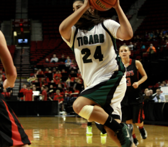 Senior Julia Santos drives to the basket.