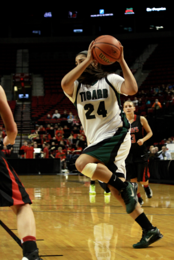 Senior Julia Santos drives to the basket.