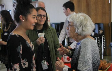 Senior Brittney Eng chats with one of the senior citizens during the senior citizen prom.