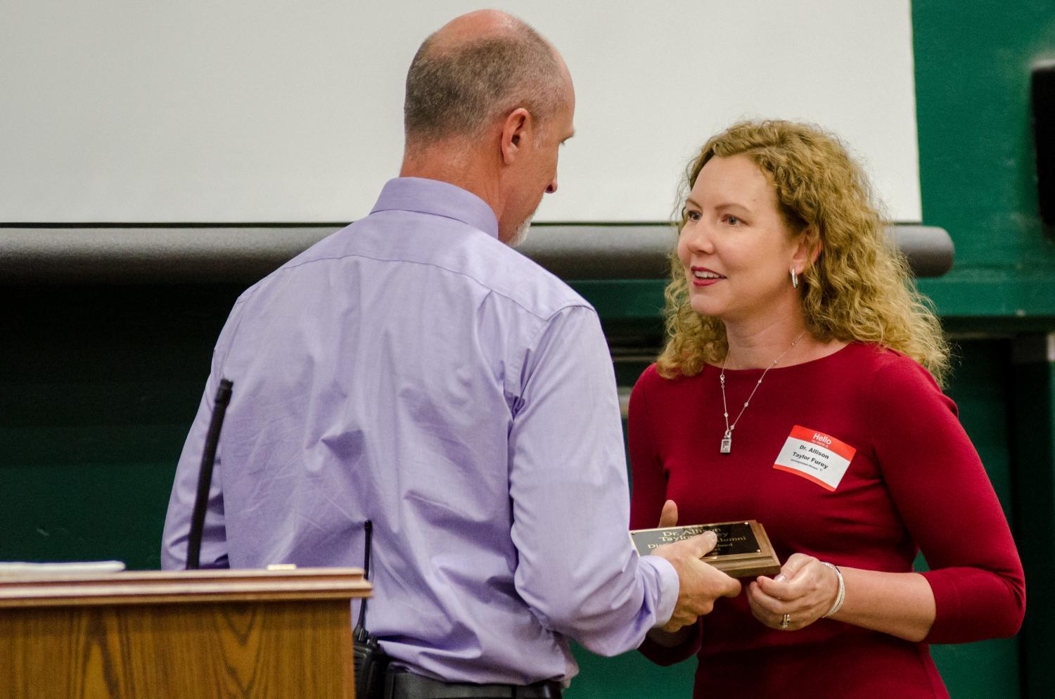 Dr. Allison Taylor Furey receives her Distinguished Alumni award at the Tiger Pride Assembly on April 28.