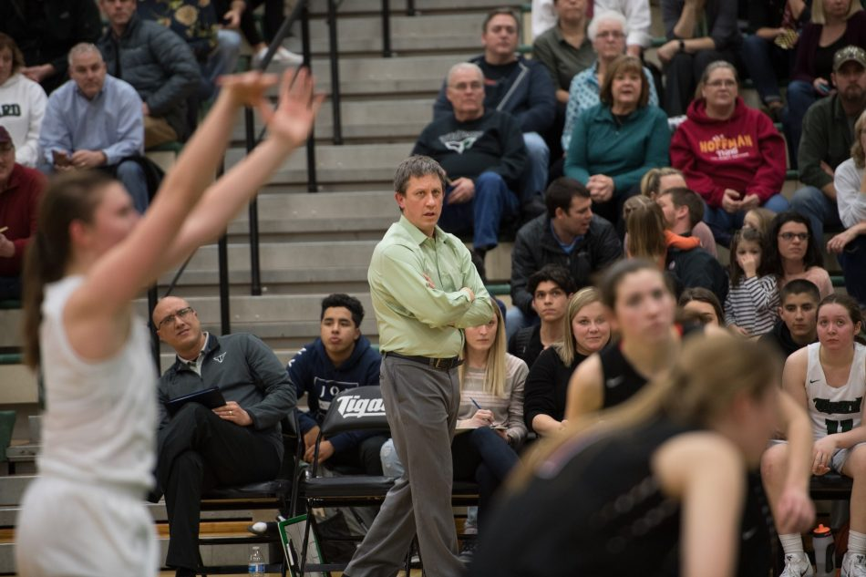 Coach Steve Naylor during the Canby game, watching sophomore Campbell Gray shooting free throws.