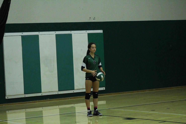 Freshman Penelope Cruz takes a deep breath before serving the ball