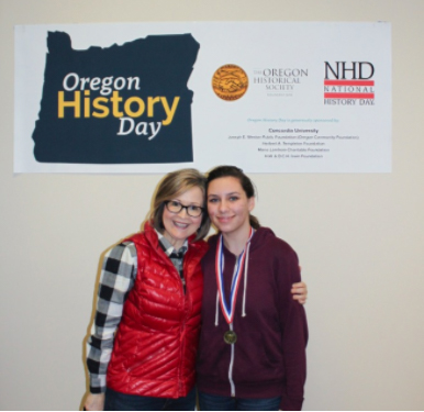 Kennedy Parish with US History teach Dani Rowe, smiling at the Oregon's History Day as Parish received 1st place in her division.