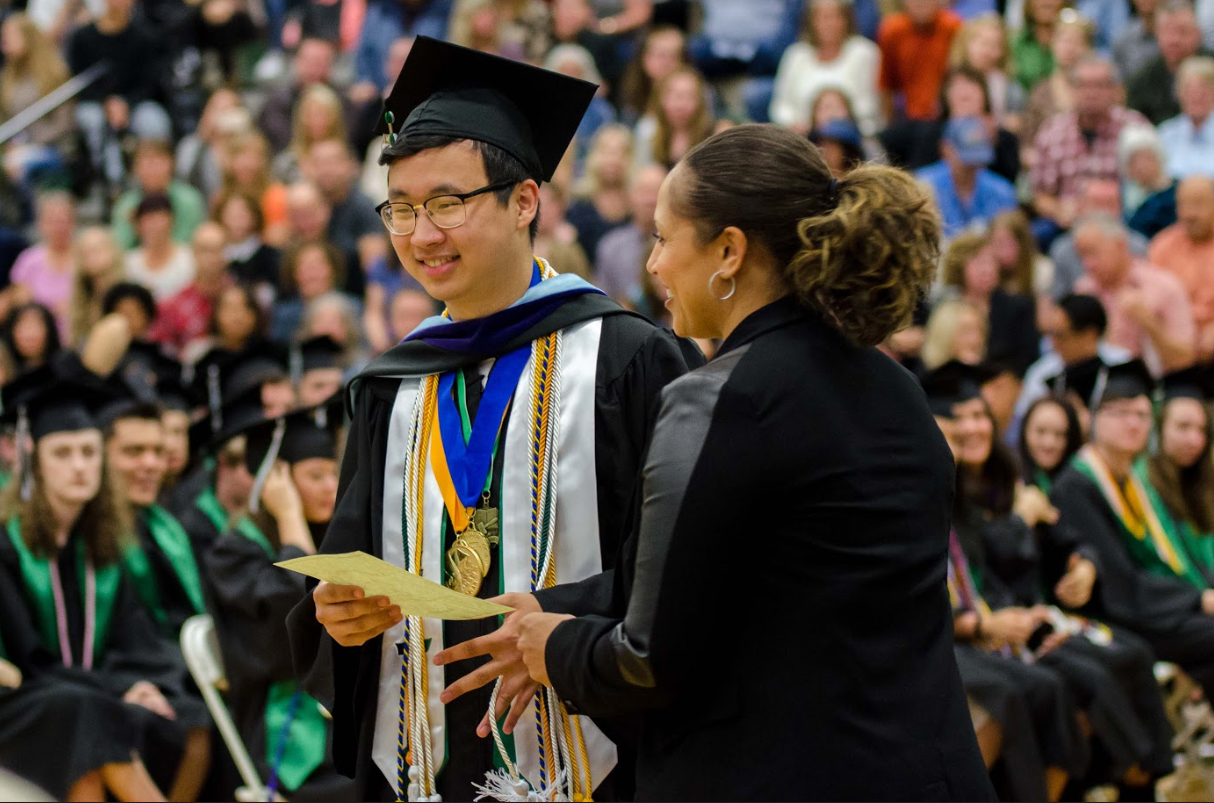 Peter Kwak accepts one of his scholarships at the Senior Award Assembly