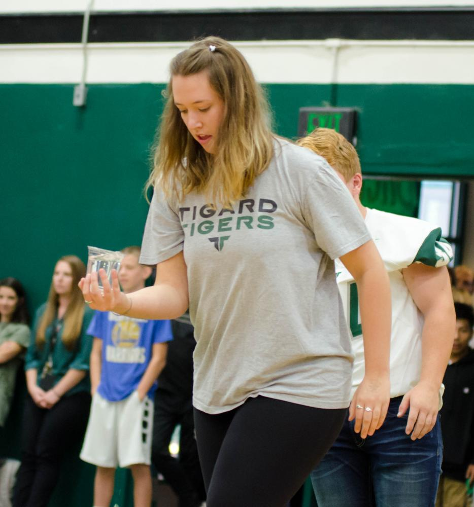 Annie Nihill competes in the cup of water walk for her senior team at the back-to-school assembly.