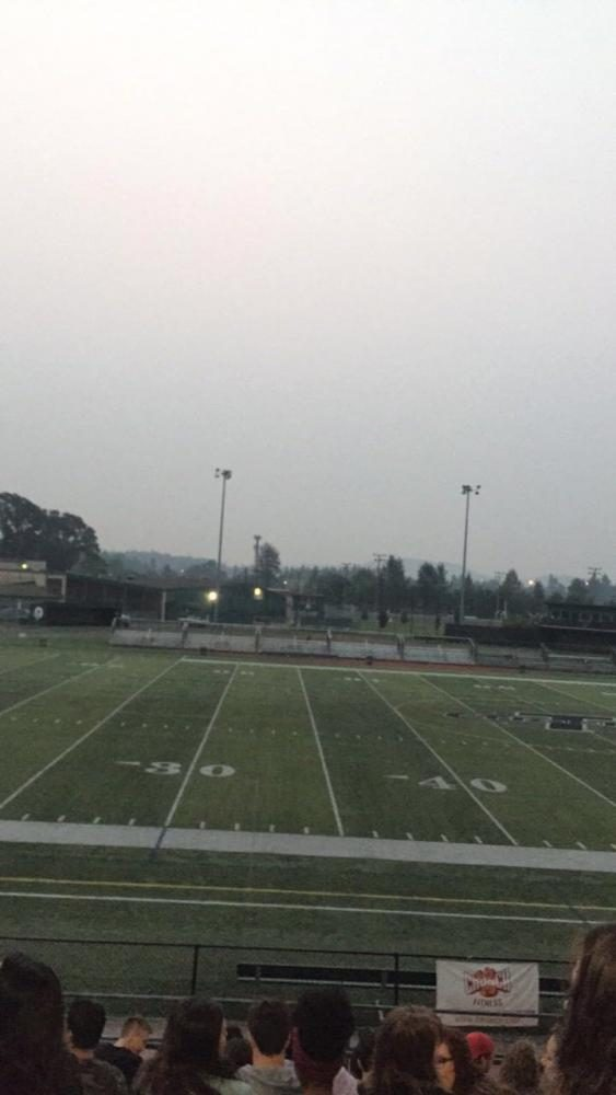 As seniors gather to watch the Senior Sunrise a cloud of smoke covered the sky.