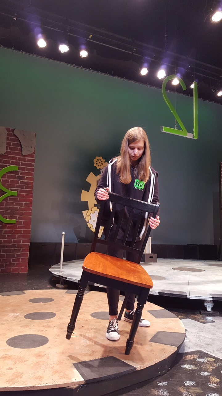 Sophomore Talia Yake helps with a set change at the dress rehearsal of