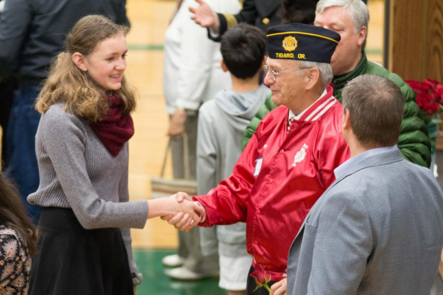 At the end of the Veterans Day Assembly, students are encouraged to shake hands with the veterans in attendance.