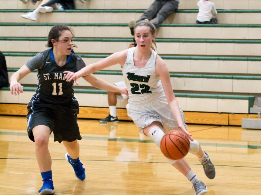 Delaney+Leavitt+drives+to+the+basket+in+a+game+against+St.+Mary%27s.