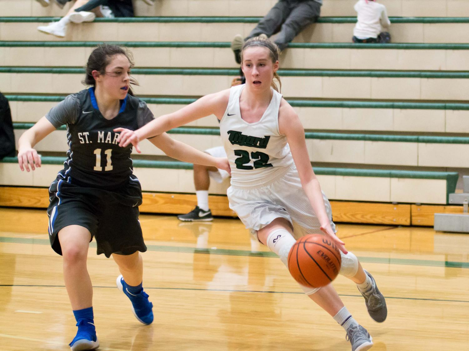 Delaney Leavitt drives to the basket in a game against St. Mary's.