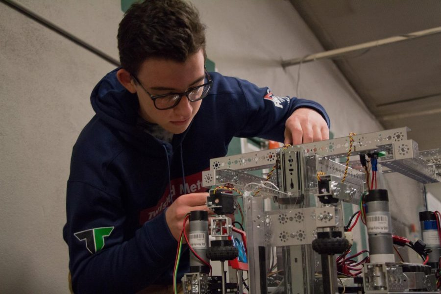 Jeremy Hancock works on his teams robot tonight. State competition begins tomorrow.