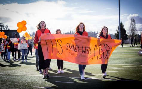 The student-led walkout as part of the March for Our Lives Movement was one event that defined 2018. Jessica Woolfolk, Meghan Turley and Baylee Berquist organized the walkout and held the banner.