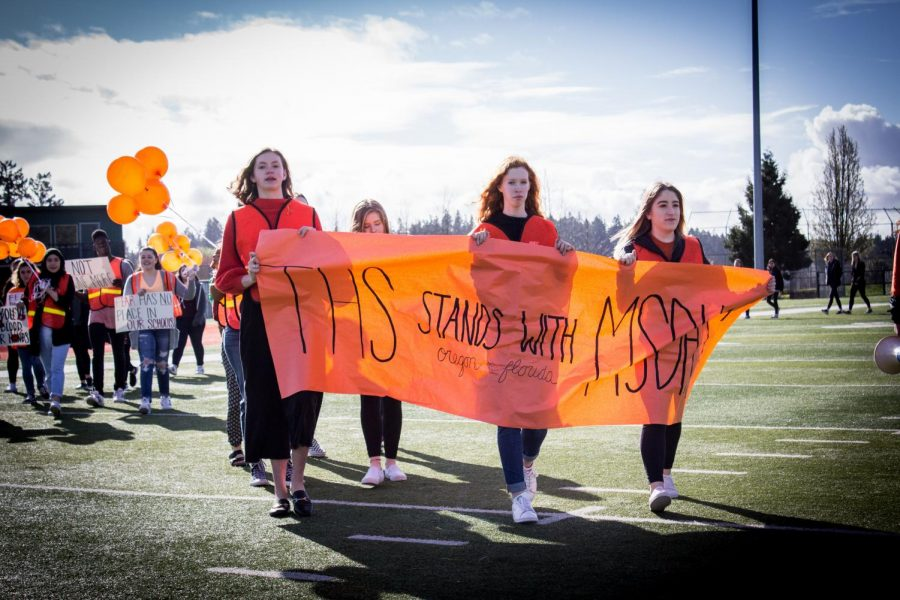The+student-led+walkout+as+part+of+the+March+for+Our+Lives+Movement+was+one+event+that+defined+2018.+Jessica+Woolfolk%2C+Meghan+Turley+and+Baylee+Berquist+organized+the+walkout+and+held+the+banner.
