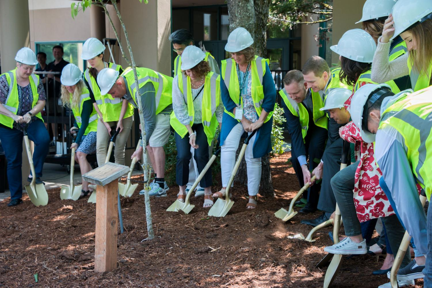 School board members 'break the ground' with golden shovels.