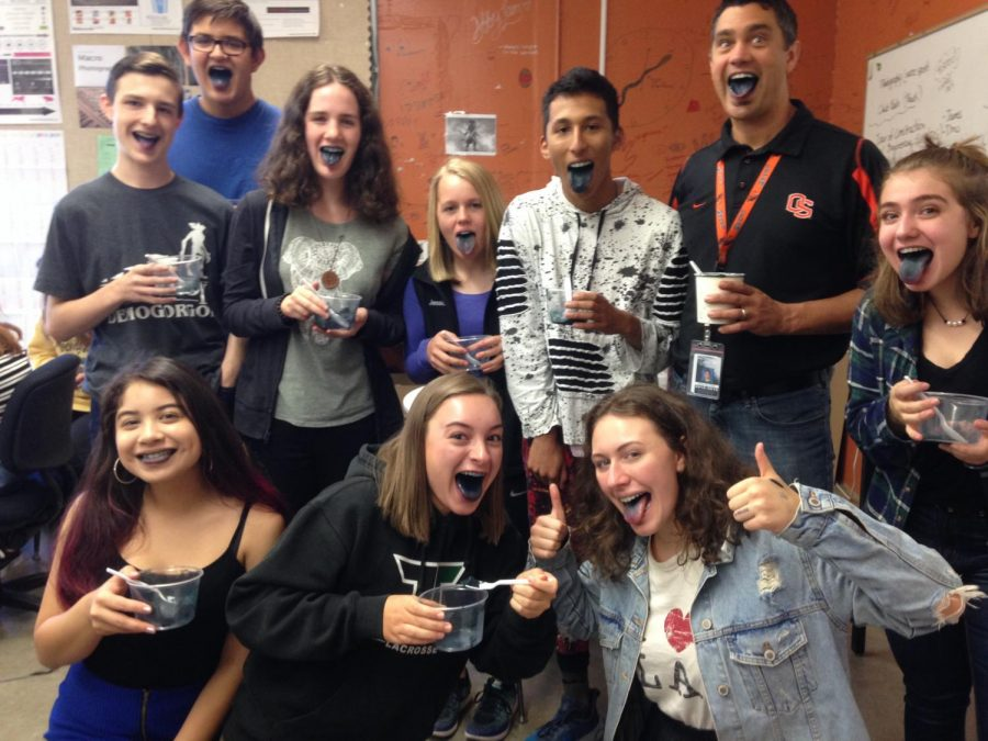 Publications students and Principal Andy Van Fleet show off their tongues after trying black licorice ice cream during class. Van Fleet said it was his favorite flavor so publications put it to the test.