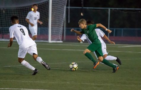 Junior Midfielder Trevor Smith (3) creates an attack play against two defenders from Hillsboro High School. Tigard won 1-0.