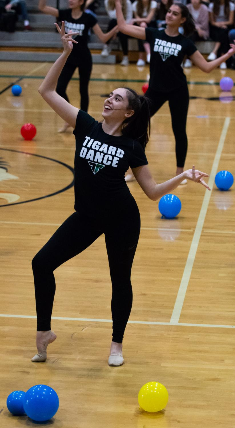 Senior, captain Abby Mullins performs with Tigerettes during the homecoming assembly. The assembly included some games, the Tigerettes performance and introduced the homecoming court to the student body.