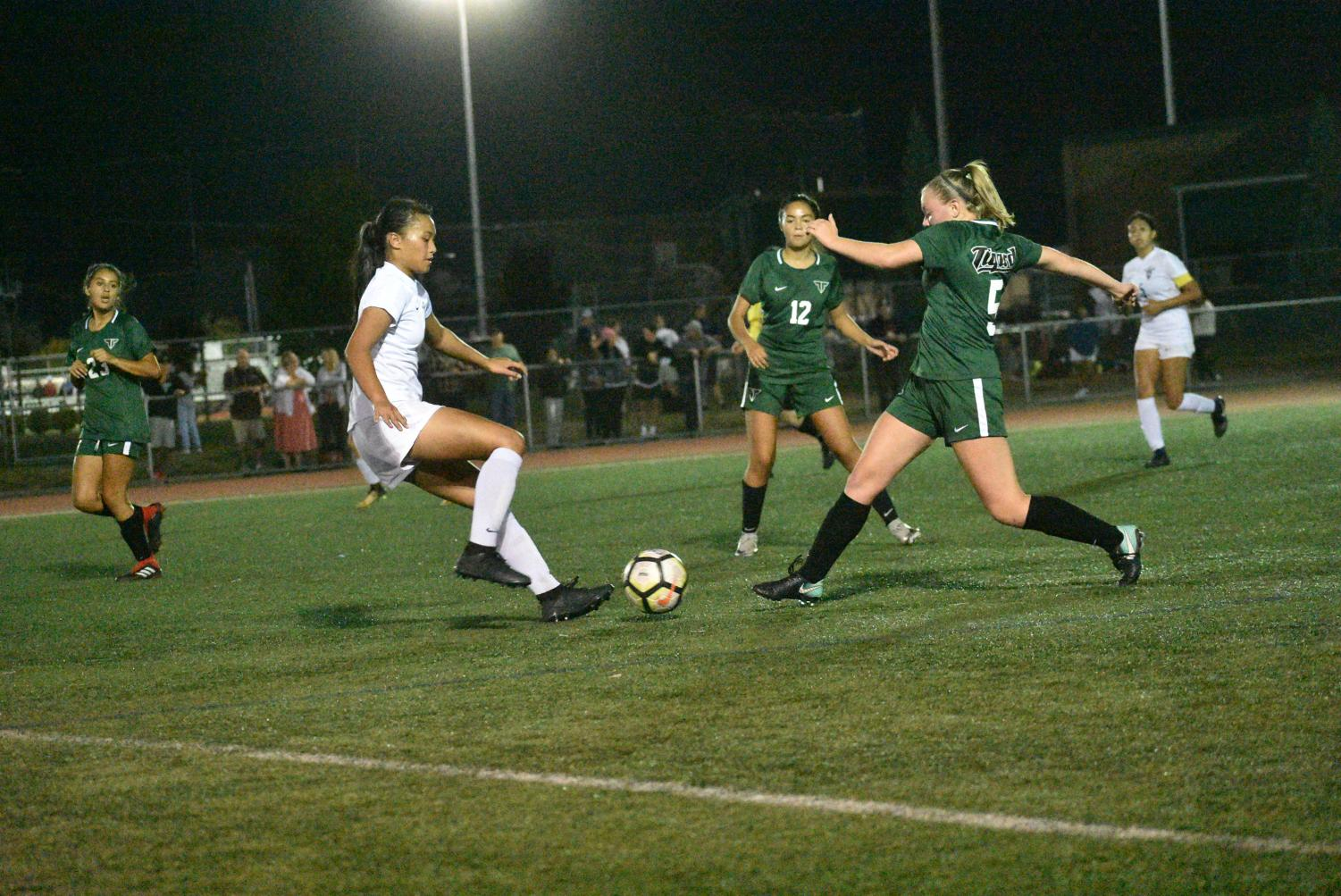 Varsity soccer player, senior Sydney Leinberger, surges through Liberty's defense. Tigard won the Sept. 27 game 5-0.