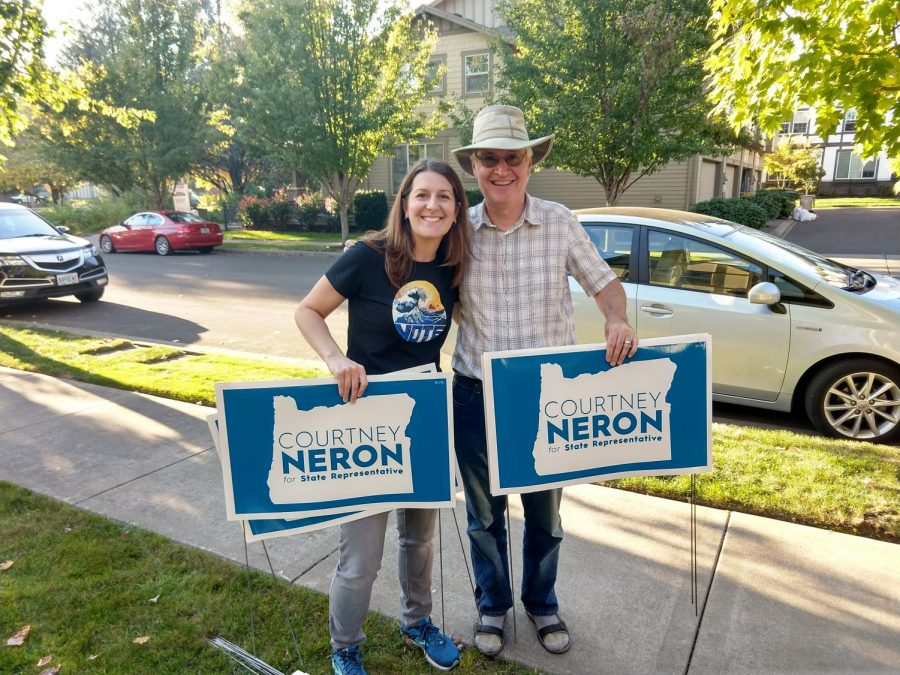 Courtney+Neron+distributes+her+lawn+signs+with+a+supporter%2C+John+Vandenberg+of+Sherwood%2C+who+helped+fund+lawn+signs.