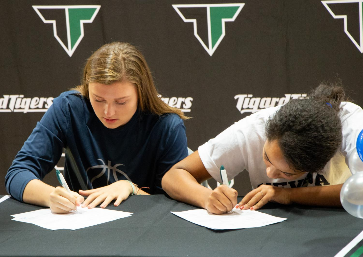 Campbell Gray and Gabby Brown sign letters of intent on Nov. 14. Gray plans to attend UC Davis to play basketball and Brown will go to Reno-Nevada to play soccer.
