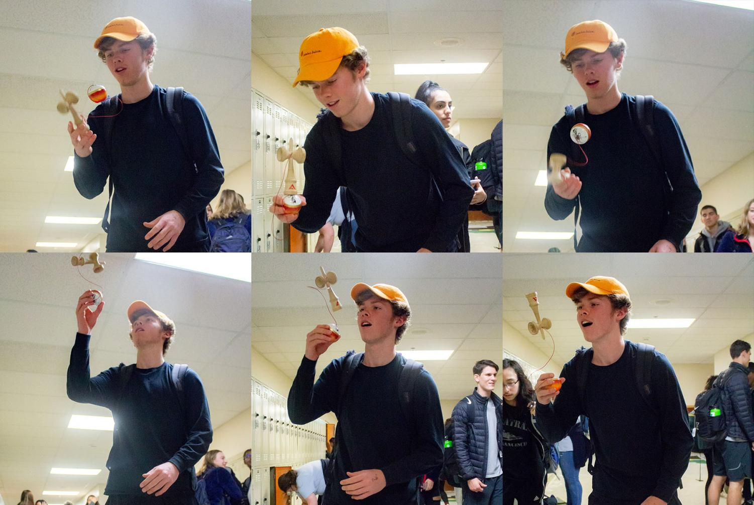 Kendama kid, junior Nathan Williams shows his skill in the hall during passing time.