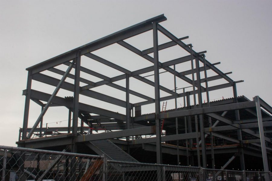 The+weather+may+be+rainy+but+construction+continues+on+the+stairwell+in+the+new+commons.+Construction+is+currently+running+two+weeks+behind+schedule+and+builders+have+had+to+consider+some+%22value+engineering%22+to+keep+costs+down.+