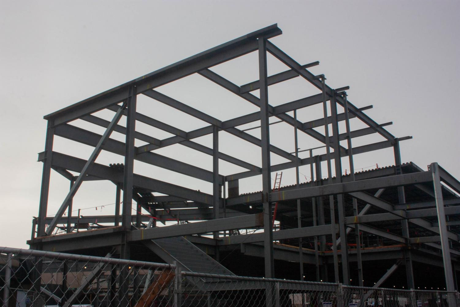 The weather may be rainy but construction continues on the stairwell in the new commons. Construction is currently running two weeks behind schedule and builders have had to consider some