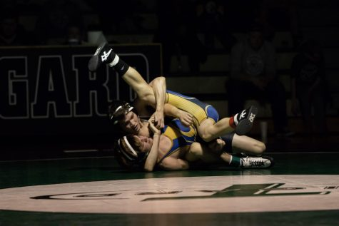 Varsity wrestlers pin down Canby