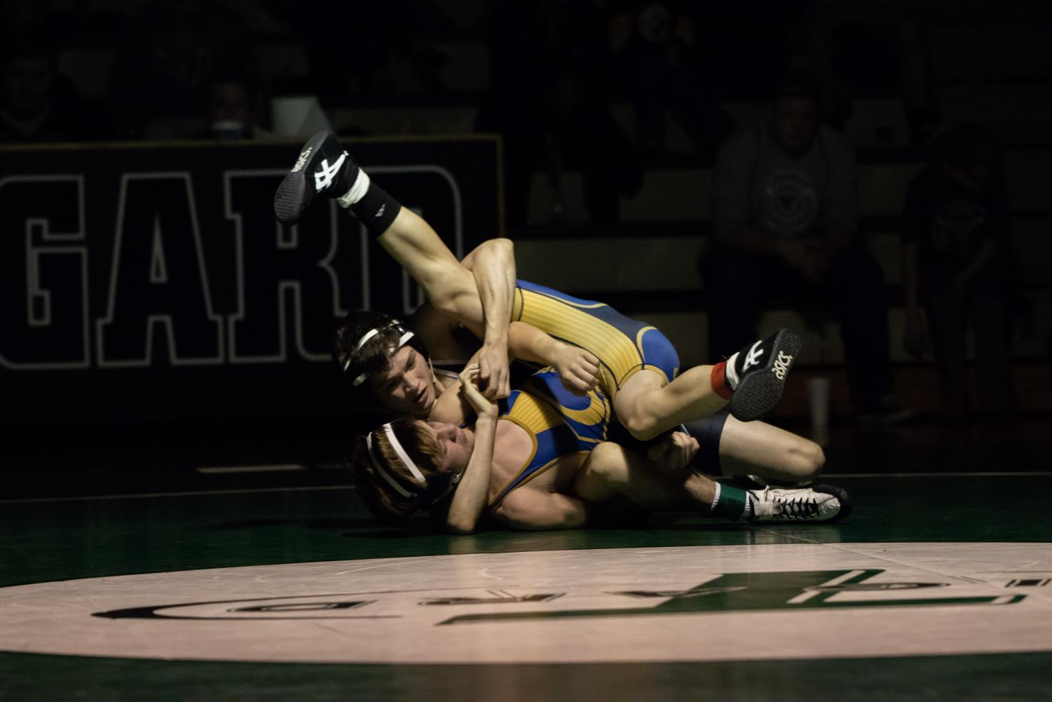 Cameron O'Connor takes on Ty Ewers of Canby. O'Connor won the match by techfall and helped Tigard win the dual meet 45-28.