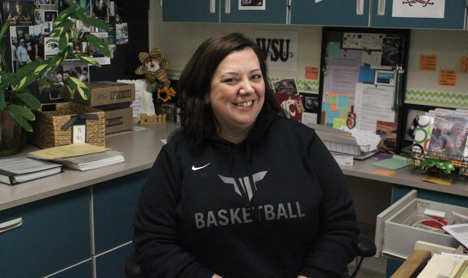 Patti Mason always has a smile for students. She found her place at Tigard.