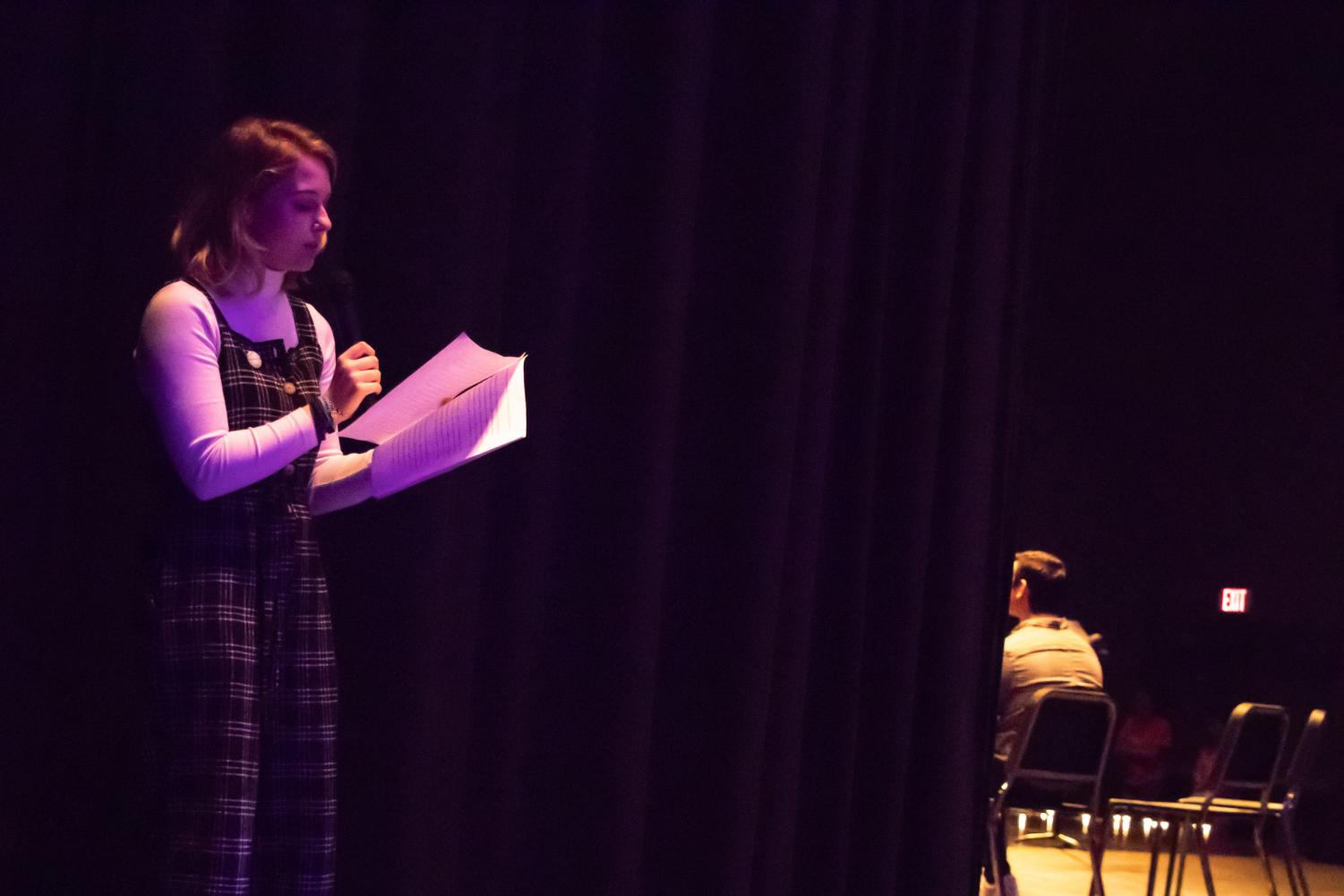 Chloe Skinner reads her story at HR Assembly on March 14. Skinner and a  specially selected group of students read stories about their struggles from behind the theater curtain. Afterwards, they all elected to go out on stage and reveal themselves to their peers.