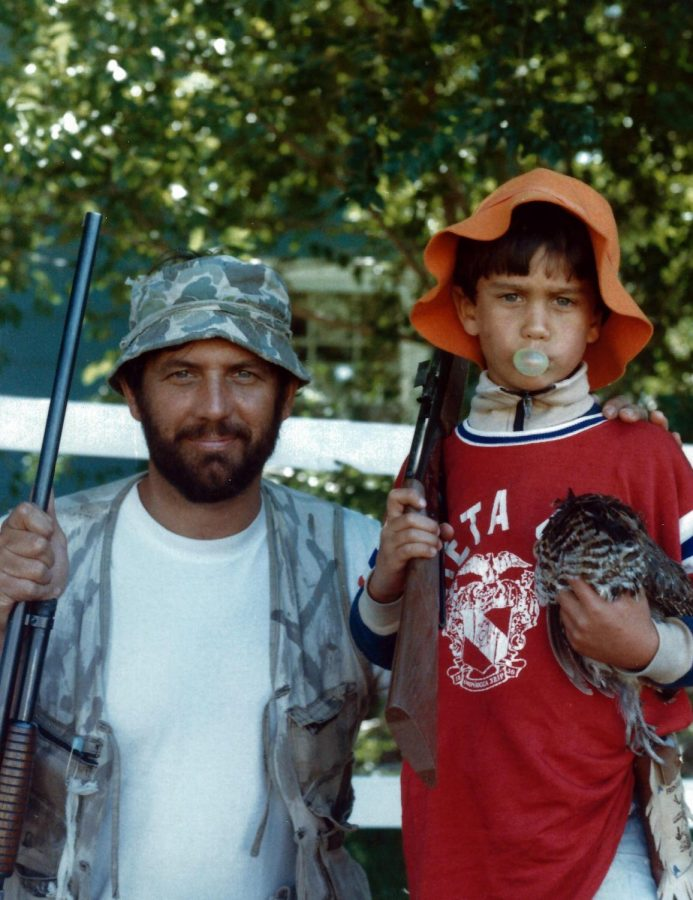 This is a classic family photo from principal Andy Van Fleet's family album. Van Fleet's mom Sheryl called this the quintessential photo of little Andy hunting grouse with his dad. Just as she clicked the shutter, Andy blew a giant bubble