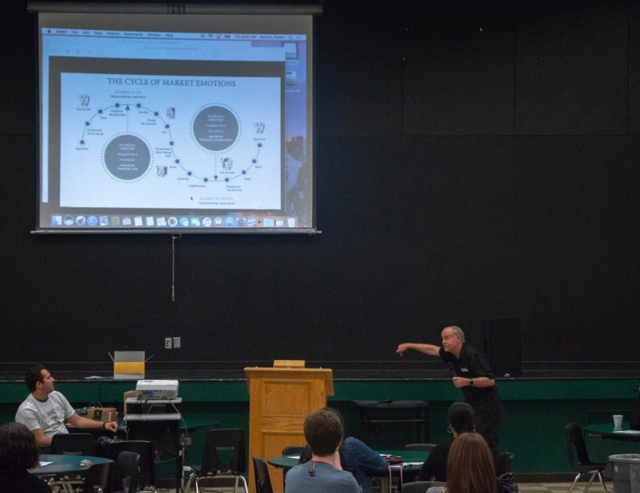 Bob Gillingham, or Mango Bob, discusses the emotional cycle that can interfere with investments at Finance Fest on April 25. Students were able to eat dinner and attend sessions to learn about finance.