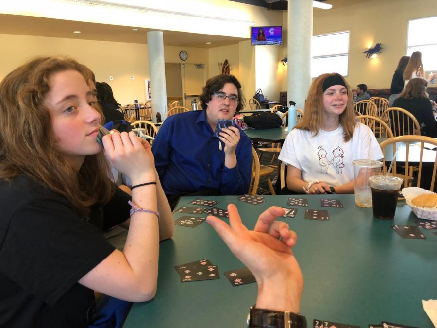 Speech and debate team play a game of 'Go  Fish' to pass time at the three day long tournament,