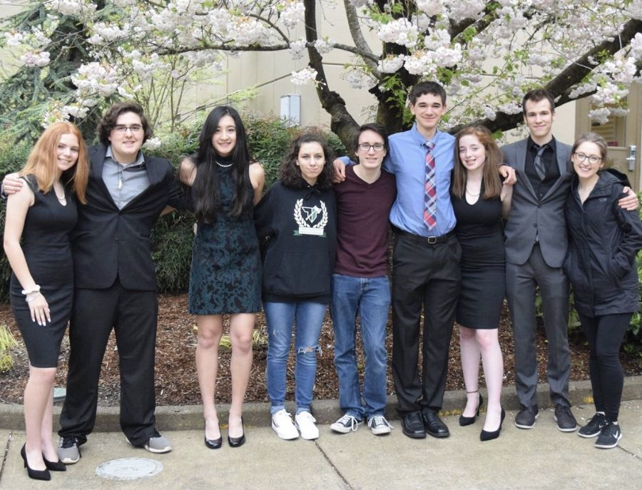 Speech and debate team huddles together at Western Oregon University. During their free time at the competition, they had card games, food runs, Goodwill hauls and swam in the Best Western hot tub.