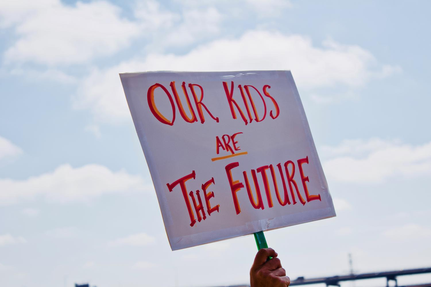 Signs+at+the+rally+included+phrases+such+as+%22Our+kids+are+the+future%22