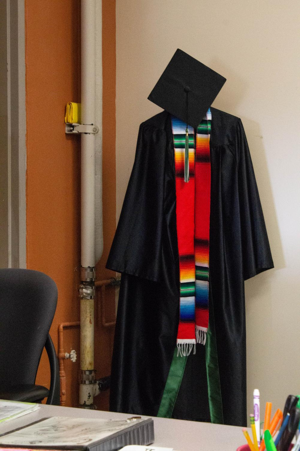 When CE2 students graduate early, they get to put on the cap and gown and have their photos taken. They can also return to walk with the rest of the class at graduation.