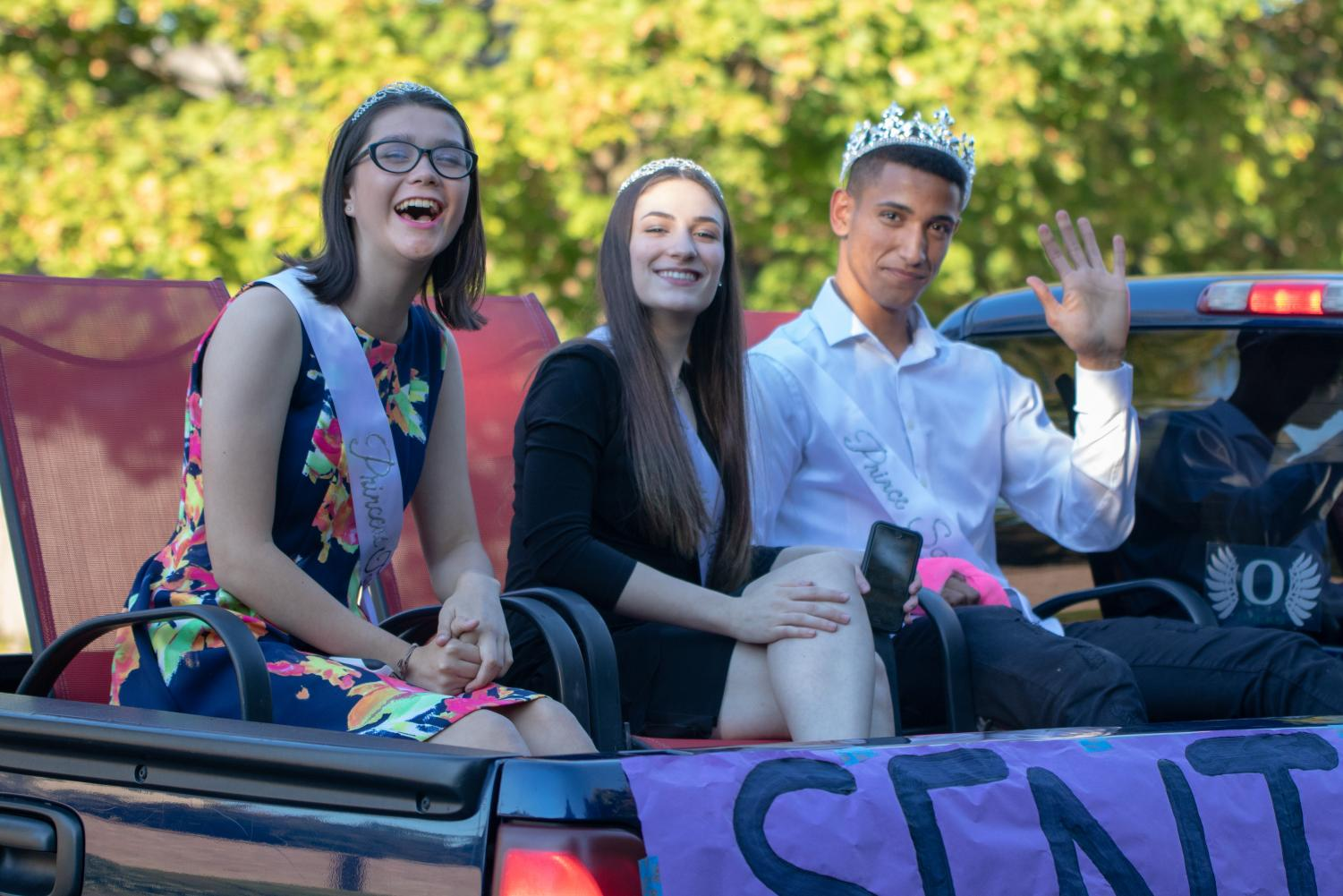 Senior Tori Lopez is real Tigard royalty. Lopez (left) rode in the homecoming float with Linnea Hill and Sajjad Al Rikabi. Lopez was nominated as the homecoming queen in the fall and a Rose Princess this spring.