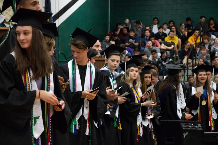 20 valedictorians receive their medals at the senior awards assembly. Valedictorians must maintain a 4.0 GPA for four years of high school.