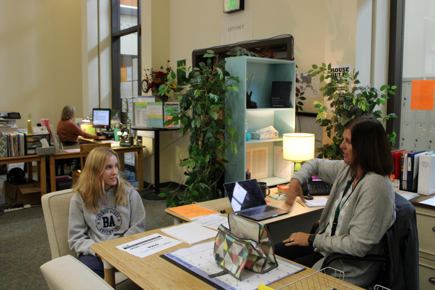 Counselor Tori Alderman chats with publications junior Sophie Fenton about the construction.  Alderman appreciated the students' patience with the current lack of privacy in the counseling office.