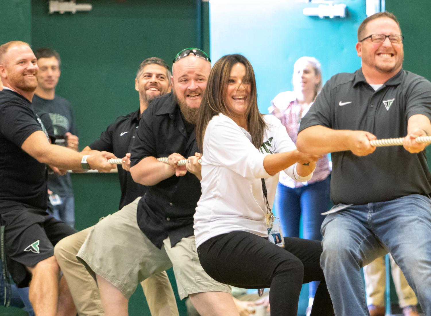 Principal Brian Bailey stacks the administrative team in the tug of war. In addition to vice principals Angelita Miller and Tyler Davila, he got a little help from wrestling coach Kaleb Reese and head football coach John Kemper.