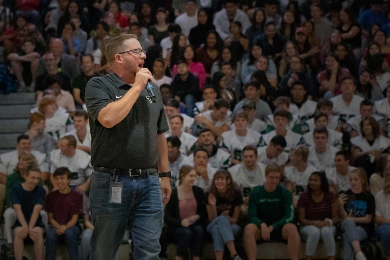 Principal Brian Bailey speaks to students at the Welcome Back Assembly. For some students the assembly was the first time they had seen the new principal.