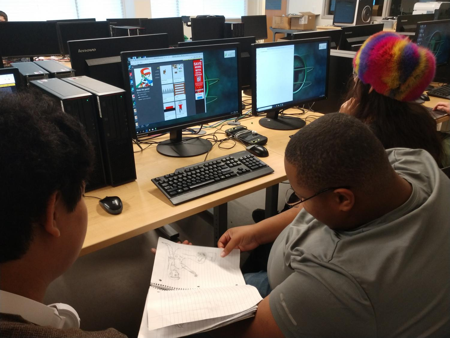 From left to right: Khanh Nguyen (10), Xavier Walker (12) and Jimmy Nguyen (12) look through a sketchbook to compile ideas for their game. Studio Gemini is recruiting members to compete in this year's OGPC.