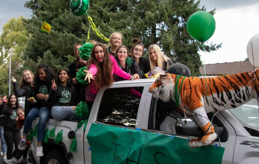 "The Varsity Volleyball team throws candy at the people observing the parade. ""It was very exciting and fun mainly because I love spending time with my teammates."" Junior Avery Croxton said. Being on a float in the parade can be a lot of fun for clubs and teams because you get extra time to hang out with the members of it. The homecoming parade is a great way to have people in the community come together to congratulate students on their achievements."