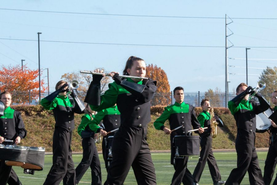 Madison Hotchkiss (front) and the rest of the band participate in the NWAPA Championship on Nov. 2. The team brought home the title for the 12th time.