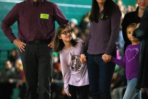 Sparrow Ellie and her family join students in the gym for the annual Sparrow Assembly. At the assembly, Sparrow Club partnered with BlackRock Coffee Company to inspire students to serve their community.